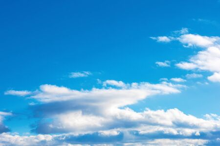fluffy clouds on the azure winter sky. sunny weather. beautiful nature background for compositing Stock Photo