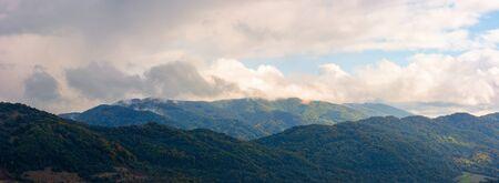 wonderful mountainous panorama in autumn. gorgeous cloudscape over the mountainwonderful mountainous panorama in autumn. gorgeous cloudscape over the mountain