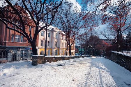 uzhgorod, ukraine - 06 JAN, 2019: urban winter day. wonderful sunny weather. Zhupanatska street covered in snow. popular travel destination. long exposure