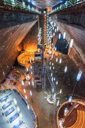 TURDA, ROMANIA - APR 30, 2018: Hall of Salt Mine Salina Turda museum. popular travel destination. underground place with ferris wheel, tennis courts and opera. Editorial