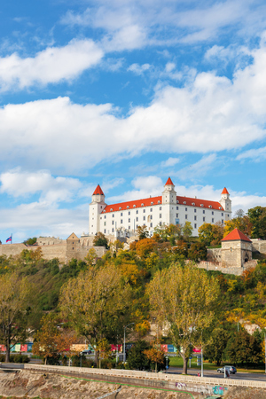bratislava castle on the hill. beautiful travel destination of slovakia. sunny autumn weather with fluffy clouds on the sky Editorial