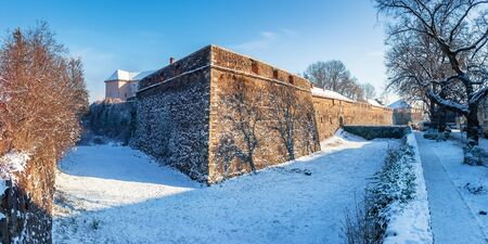 Uzhhorod, ukraine - 03 JAN, 2009: panorama of uzhgorod castle on a sunny winter day. popular travel destination of transcarpathia which also serves as a museum