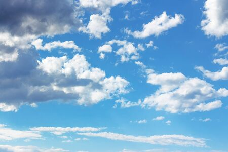 blue sky with clouds on a sunny april day. dynamic formations in windy weather Stock Photo