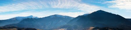 panorama of mountains with snow capped tops above the rural valley. wonderful weather condition of november. borzhava ridge with Velykyy Verkh, Play and Temnatyk peaks