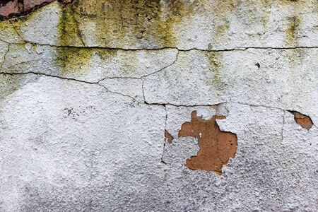 old white wall with cracks. abstract ruin architecture texture. devastation background concept. close up view Stock Photo
