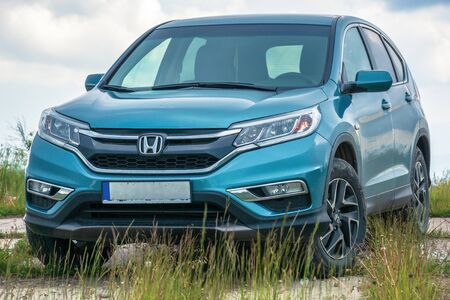 mnt. runa, ukraine - jun 22, 2019: popular family SUV in mountains on a cloudy day. 4th generation of a honda cr-v, in blue color. all wheel drive vehicle on a paved platform. car adventure concept Editorial