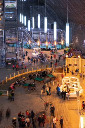 TURDA, ROMANIA - APR 30, 2018: Hall of Salt Mine Salina Turda museum. popular travel destination. underground place with ferris wheel, tennis courts and other playgrounds Editorial