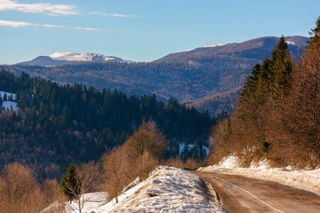 asphalt mountain road in winter. beautiful sunny day Stock Photo