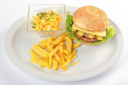fast food menu. hamburger, french fries and salad. burger with beef stake, cheese onion and pickle. healthy variation of junk food Stock Photo