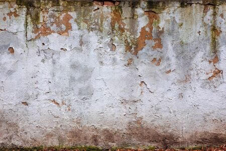 old white wall with cracks. abstract ruin architecture texture. devastation background concept Stock Photo