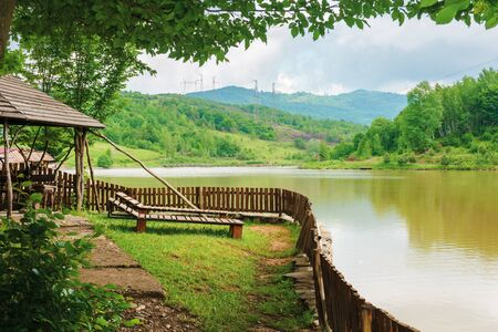 place for rest on the shore of mountain lake. beautiful nature scenery in spring time.place for rest on the shore of mountain lake. beautiful nature scenery in spring time.