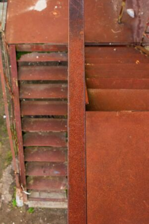 metal stairs. abandoned urban background full of rusty texture. view downside Stock Photo