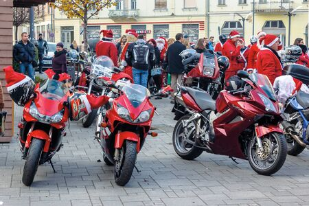 nyiregyhaza, hungaria - 07 DEC 2014: people dressed as santa claus on motorcycles. annual santa-themed charity fundraiser event on second sunday of advent organized by local biker club Stock Photo - 137011106