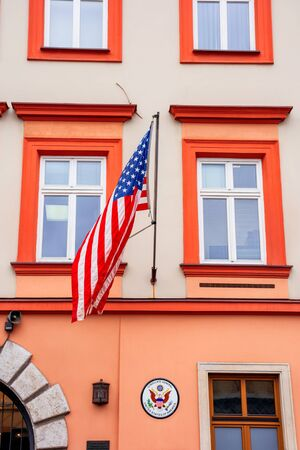 Krakow, poland - APR 30, 2019: American flag on facade of United States Consulate General Krakow located in historic center of an old town