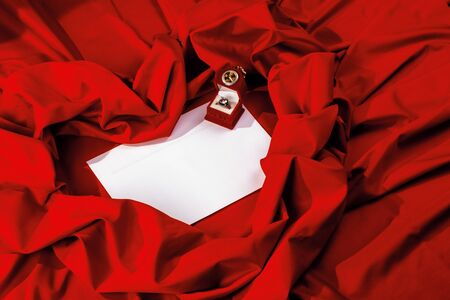 valentine card composition on a red fabric. there is always some madness in love let me be yours message.  Stock Photo