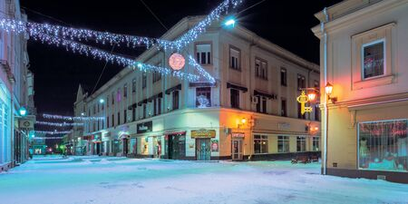 uzhhorod, ukraine - 06 JAN, 2019: christmas night scenery of uzhgorod. colorful glowing decorative illumination on korzo street. festive mood. happy holidays