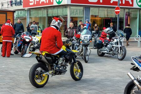 nyiregyhaza, hungaria - 07 DEC 2014: people dressed as santa claus on motorcycles. annual santa-themed charity fundraiser event on second sunday of advent organized by local biker club Editorial