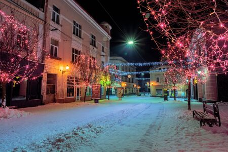 uzhhorod, ukraine - 06 JAN, 2019: christmas night scenery of uzhgorod. colorful glowing decorative illumination on voloshyna street. festive mood. happy holidays