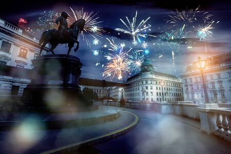 celebrate abstract holidays in vienna, austria, europe. christmas or new year fireworks at night. composite imagery
