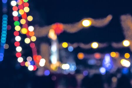 christmas lights on the streets at night. abstract blurred background toned in blue Stock Photo - 136867915