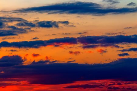 orange sunset sky with clouds. beautiful nature background Stock Photo - 136867623