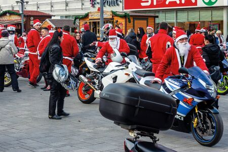 nyiregyhaza, hungaria - 07 DEC 2014: people dressed as santa claus on motorcycles. annual santa-themed charity fundraiser event on second sunday of advent organized by local biker club Stock Photo - 137012923