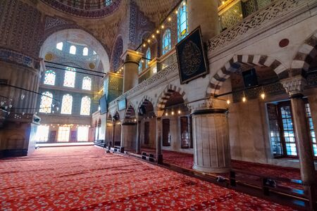 istanbul, turkey - AUG 18, 2015: inside interior of blue mosque also known as sultan ahmed. functioning mosque is a popular travel destination
