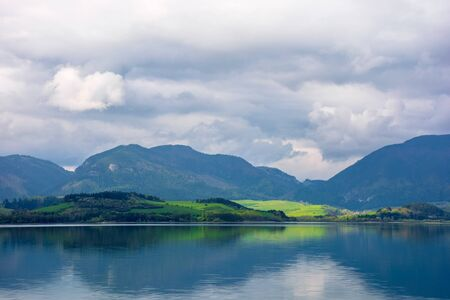lake liptovska mara in slovakia. wondeful travel destination of high tatras mountain ridge. cloudy weather in springtime. reflection in the water
