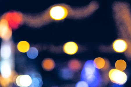 christmas lights on the streets at night. abstract blurred background toned in blue Stock Photo - 137634180