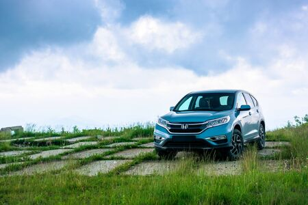 mnt. runa, ukraine - JUN 22, 2019: blue suv on a paved meadow. popular AWD vehicle in nature scenery. stormy weather with cloudy sky. take your family anywhere outdoors with honda cr-v concept Stock Photo - 140482881