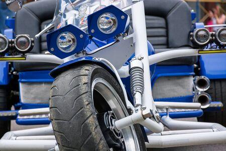 Uzhgorod, Ukraine - JUL 09, 2016: silverR trike detail shots. beautiful custom three wheel motorcycle in blue color