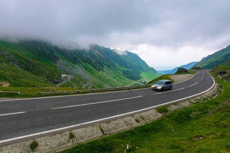 alpine road through mountain valley. epic view of transfagarasan route. popular travel destination. gorgeous landscape of fagaras mountains, romania. cloudy weather Stock Photo - 140833545