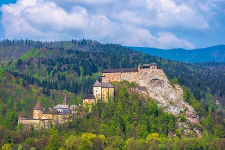 orava castle of slovakia. medieval fortress on a hill in a beautiful place in mountains. wonderful sunny weather with fluffy clouds in springtime Stock Photo - 140843030