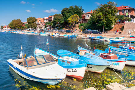 sozopol, bulgaria - SEP 09, 2019: fishing boats in port on a sunny day. embankment on the background of a scenery. garbage in the water