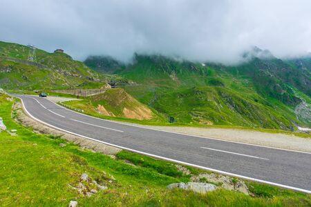 alpine road through mountain valley. epic view of transfagarasan route. popular travel destination. gorgeous landscape of fagaras mountains, romania. cloudy weather Stock Photo - 141642507