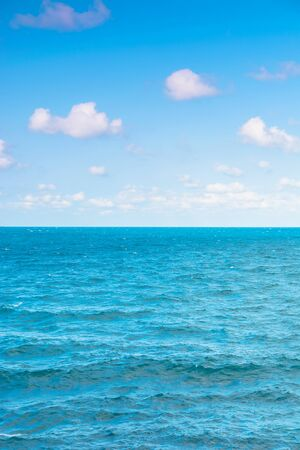 sea and sky. calm seascape with clouds on the evening sky. blue dreamy vacation background