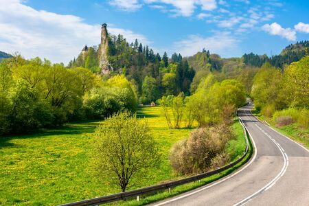 Orava Castle on the high steep rock near the rock. one of the most beautiful medieval fortress in Slovakia. popular travel destination. beautiful sunny day. trees in green foliage Stock Photo