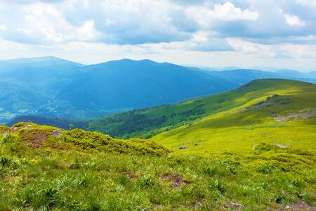 path through mountain range. beautiful alpine meadows of carpathian landscape on a cloudy day in summer. dividing watershed ridge Stock Photo