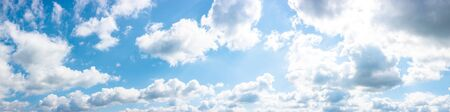 gorgeous panorama of cloudscape in springtime. weather background with dynamic cloud arrangement on a blue sky. sunny and windy day, good weather forecast concept Stock Photo