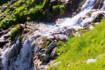 cascade of balea stream. nature scenery of fagaras mountains on a sunny summer day