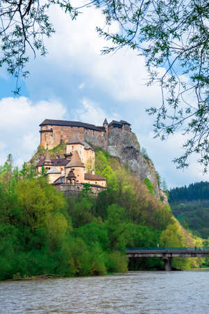 medieval orava castle on the hill. beautiful springtime scenery in dappled light above the river. popular travel destination of slovakia Editorial