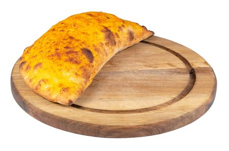 tasty homemade calzone pizza on a white plate. italian food isolated on the white background. side view Stock Photo