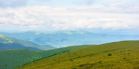 alpine scenery of carpathian mountains. stunning views on a windy summer day. clouds on the sky. ridges and valleys in the distance
