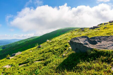 great alpine scenery in summertime. beauty if green and blue colors in nature. stunning mountain scenery in dappled light beneath a dynamic sky Stock Photo