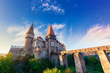 famouse corvins castle in hunedoara at sunrise. one of the largest in europe and is in a list of seven wonders of romania. fantastic morning scenery