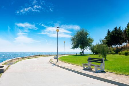 bench on the sea embankment. summer vacation and beach relax concept. nessebar beautiful travel destination of bulgaria. sunny weather