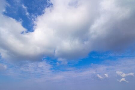 beautiful cloudscape on a summer day. wonderful sunny weather forecast. dynamic cloud formation on the blue sky