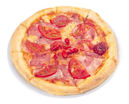 tasty homemade pizza on a white plate with tomatoes and ham. italian food isolated on the white background. view from above