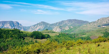 rocks and cliff of romania gorges. beautiful mountain landscape view. scenic nature of apuseni natural park. rural fields on the nearest hills. sunny day.
