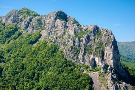 rocks and cliff of romania gorges. beautiful mountain landscape view. scenic nature of apuseni natural park. sunny day. Stock Photo